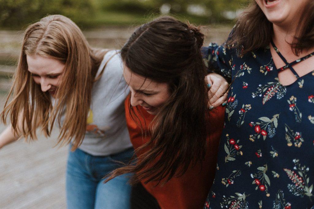 Three young women hugging