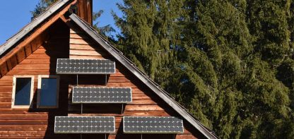 Solar panel on the front of a wood panelled house