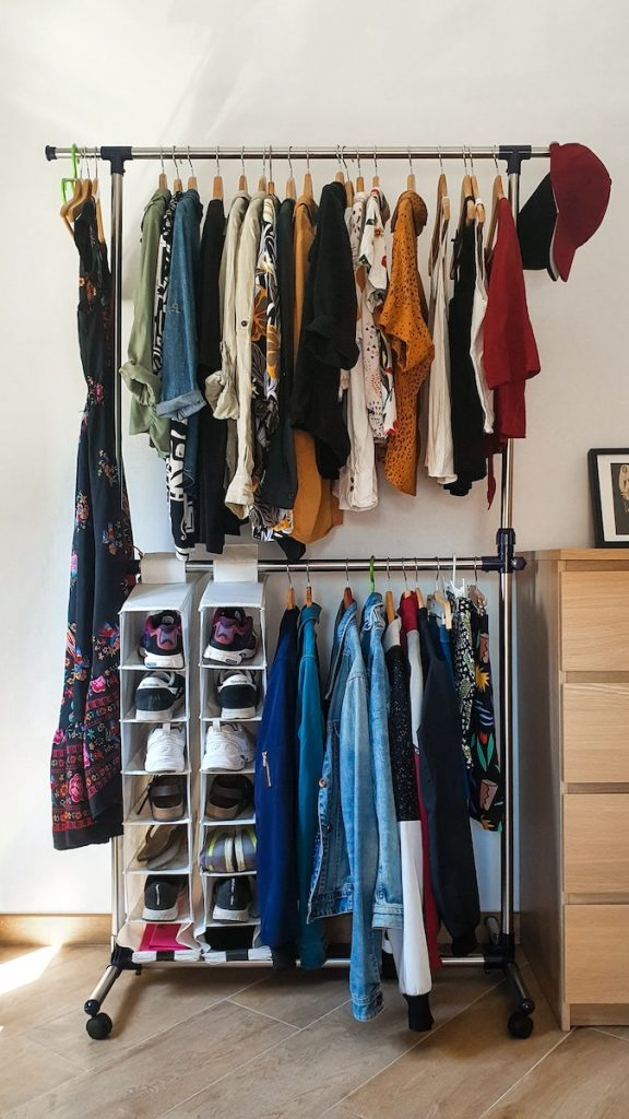 Clothing rail with clothes and shoes