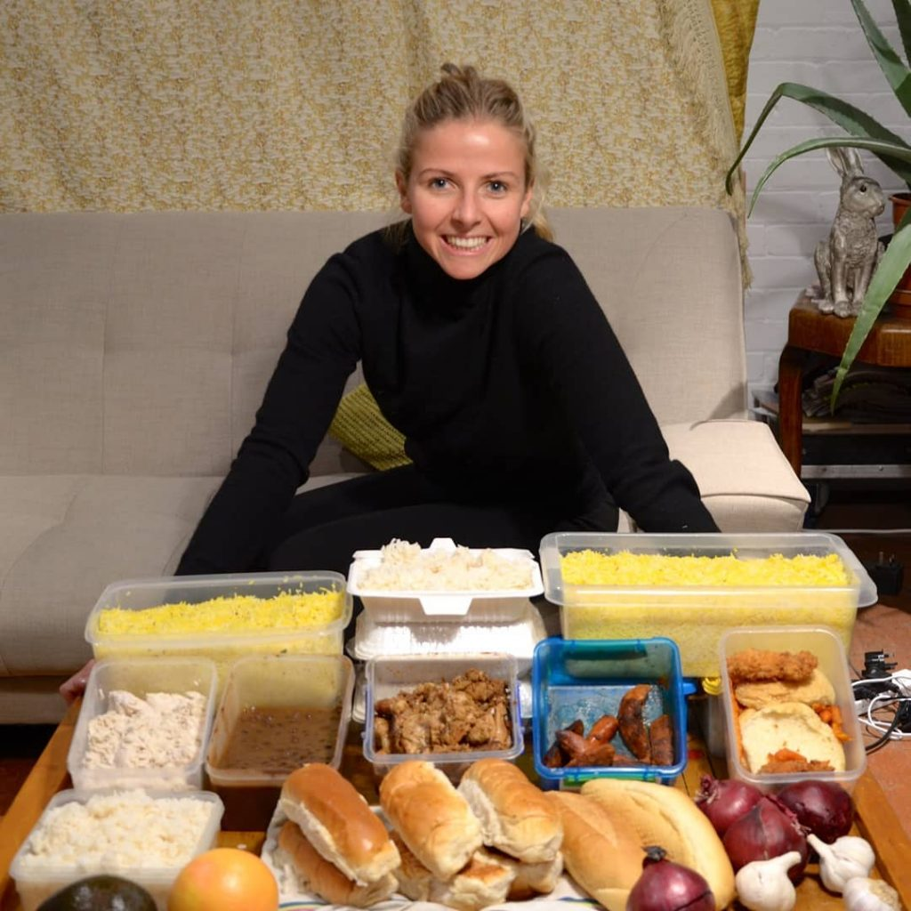 Young woman with lots of saved food