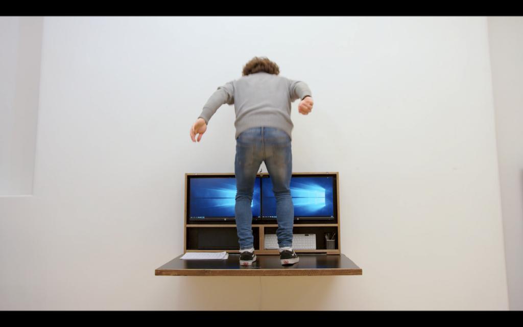 Man jumping on desk
