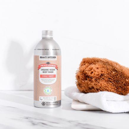 Bottle of body wash, natural sponge